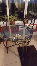 Lovely glass table with 4 chairs