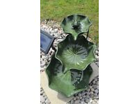 Green garden fountain with frog ornament
