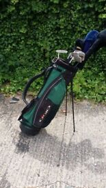 Starter golf set and bag. Putter, 4-pw plus 3,5 wood and several drivers