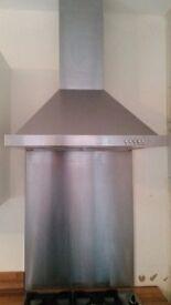 Single oven, gas hob, cooker hood and stainless steel splashback