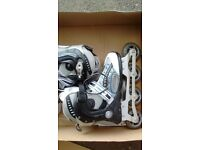 Girls inline skates. Hardly worn, excellent condition. Size 5/38 boxed.