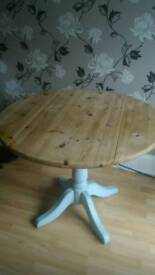 Solid wood round table with drop leaves