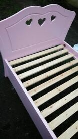 Pink single bed with drawer under