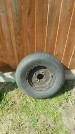 old trailer wheel