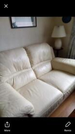 Cream two seater leather couch Excellent Condition Open to offers