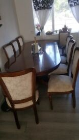 dinning table with 8 chairs paid well over £1500.00