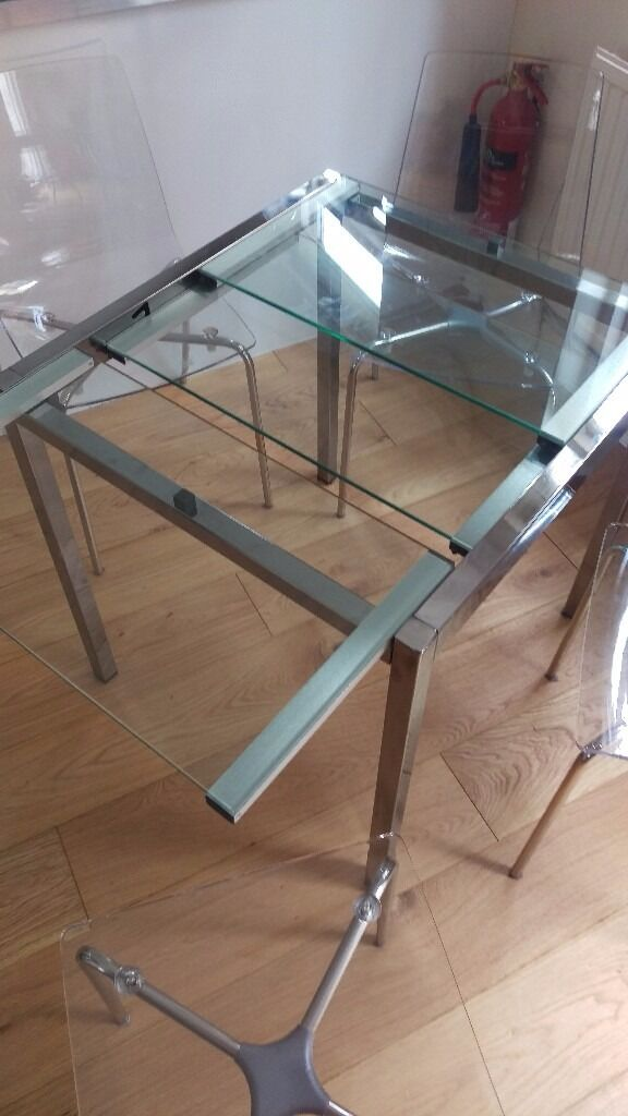 Lovely ikea glivarp glass metal extendable dining for Extendable glass dining table