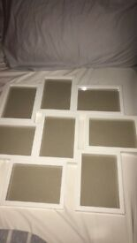 A white 8 picture frame. Used once