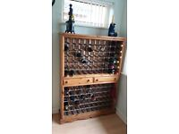 120 bottle wine rack cabinet with two central drawers in stained pine wood