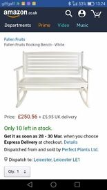 Outdoor white wooden rocking bench