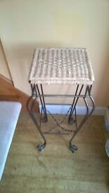Bronze effect wrought iron Jardiniere/plant stand with wicker top.