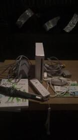 Nintendo wii console with controller and nunchuck