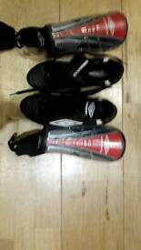 Umbra boots and shin guards