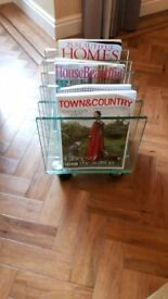 Modern Glass magazine rack on wheels