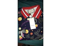 Gucci polo tshirt not Louis Vuitton