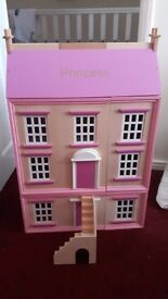 Wooden dolls house, engraved with 'princess' on the house.