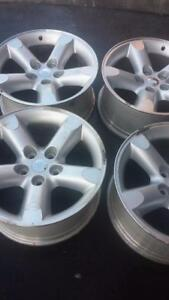 FACTORY OEM 20 INCH DODGE RAM ALLOY WHEEL SET OF FOUR IN GOOD CONDITION.