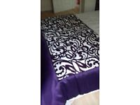 Purple and gold bedspread
