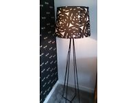 IKEA black floor lamp with black and white shade