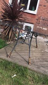 glass dining table and 6 wrought iron chairs