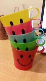 set of five plastic cups