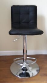 Bar stool/chair in chrome finish with faux leather covering, and telescopic height
