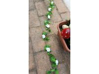 34m / 111ft of artificial white rose garlands. Perfect for weddings at a fraction of the price.