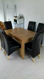 Solid oak extendable table and chairs