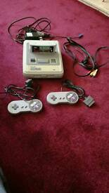 Super Nintendo with 2 controllers and one game