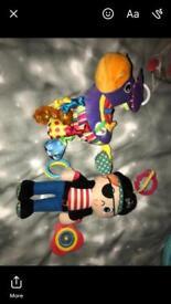 Two Lamaze pram toys