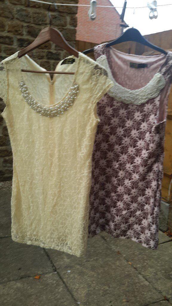 Two size L PussyCat London dresses.