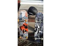 2 Skateboards with a Helmet No Fear