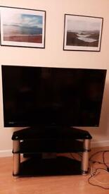 42 inch HD TV with glass cabinet/stand