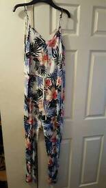 Ladies size 10 jumpsuit. New with tags!