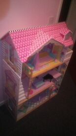 Wooden doll house in brand new condition