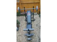 weight lifting bench with weights and dumbell