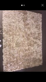 Large gold / beige rug