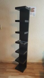 A tall black shelf in great condition