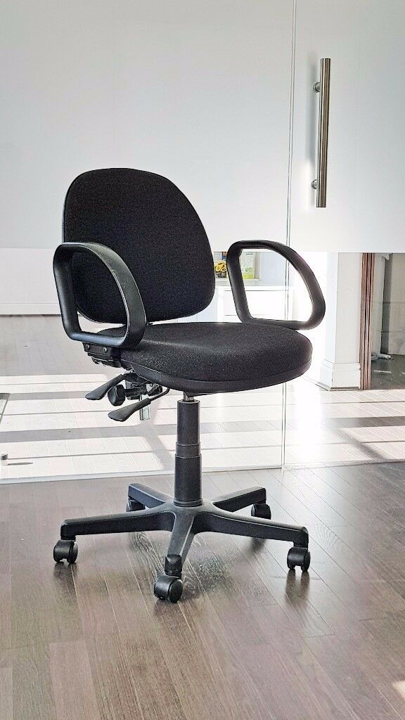 Spinning office chair, adjustable height and backrest with smooth wheels.