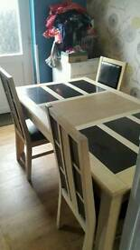 Swap. Dining table and 4 chairs.
