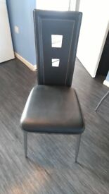 Used but still attractive black glass table /chairs