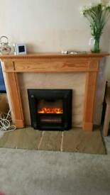 Electric fire with surrond and pine mantle piece