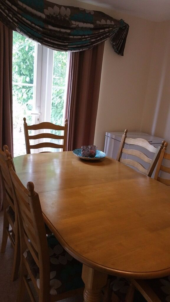 Wooden extendable dining table 6 chairs in Cambridge