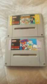 2 super Nintendo games Both mario games/ cash or swaps