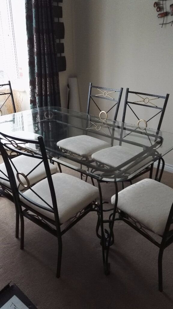 Dining table and chairsin Armadale, West LothianGumtree - Dining table and 6 chairs Glass top amd metal frame Chairs are metal frame cream fabric seats Few marks on seats Good condition table dismantled for moving. £140