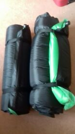 Self inflating bed rolls