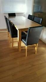 OAk Dining table with 6 black leather chairs