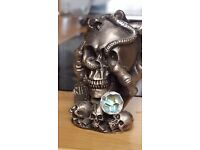 Pewter figures, skull, dragon, others