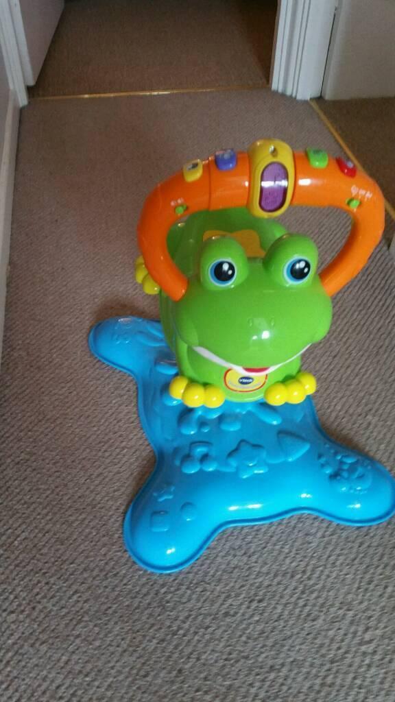 Musical frog bouncer