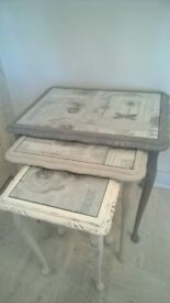 Shabby chic nest of tables with glass tops with decorative paper underneath grey light grey and wht